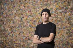 "Artist Richard Kraft poses in front of one of his pieces called ""Wing""  (Scott Smeltzer)"