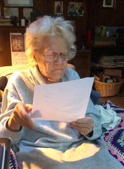 A photo of Mary Norbert Korte reading a piece of paper.